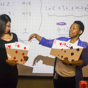 Tiffani Williams and a workshop participlant demonstrate a problem at a Break Into Tech workshop